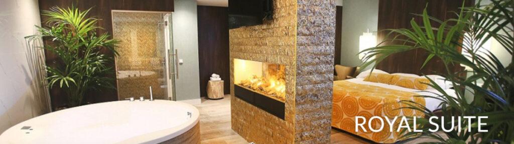 Hotelkamer met rond bad, sauna en openhaard